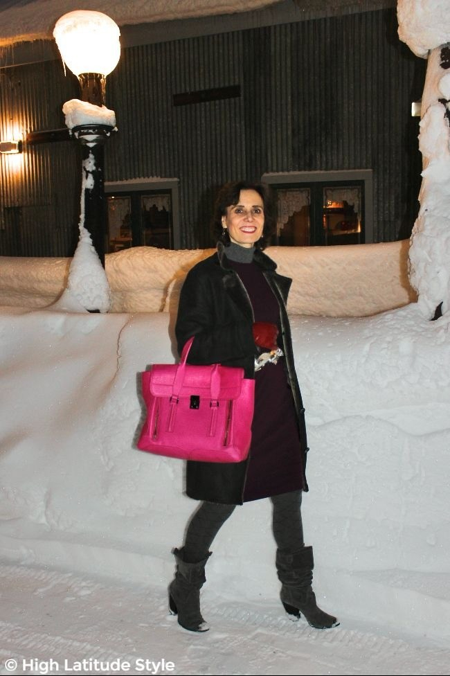 #advancedstyle woman in styled outerwear mixing fuchsia, cherry red and burgundy with gray