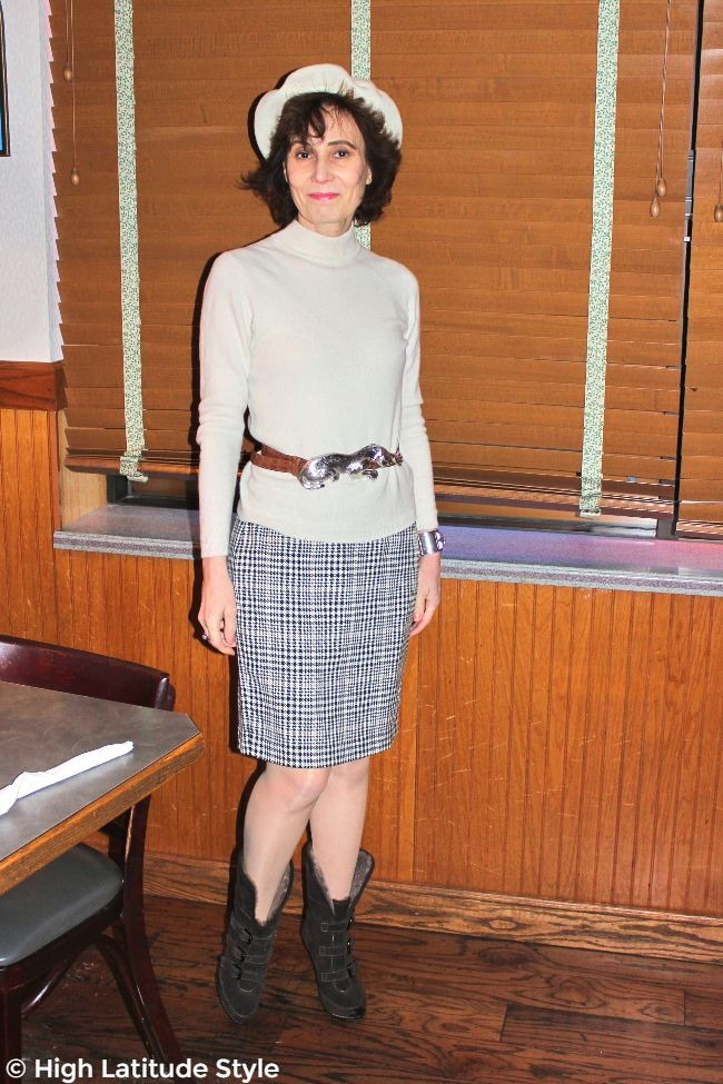 Alaskan woman in spring business casual outfit with pantyhose, but warm booties