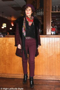 #fashionover50 older woman with Russian scarf, statement belt, colored jeans and beret