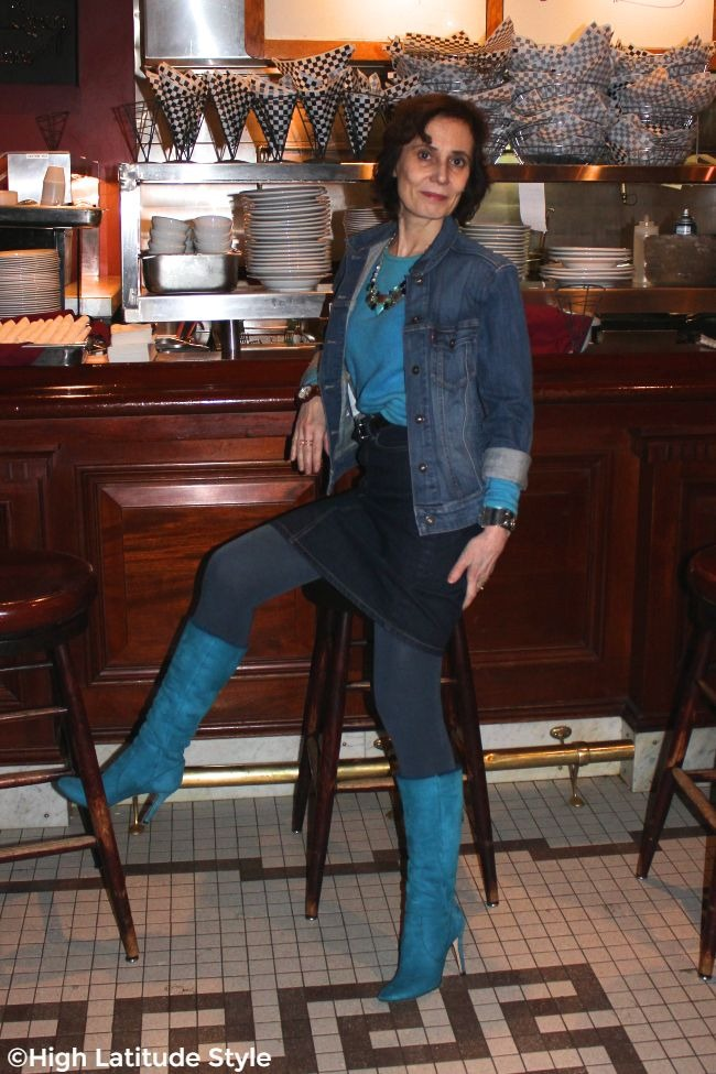 #advancedfashion woman in double denim with turquoise sweater and boots