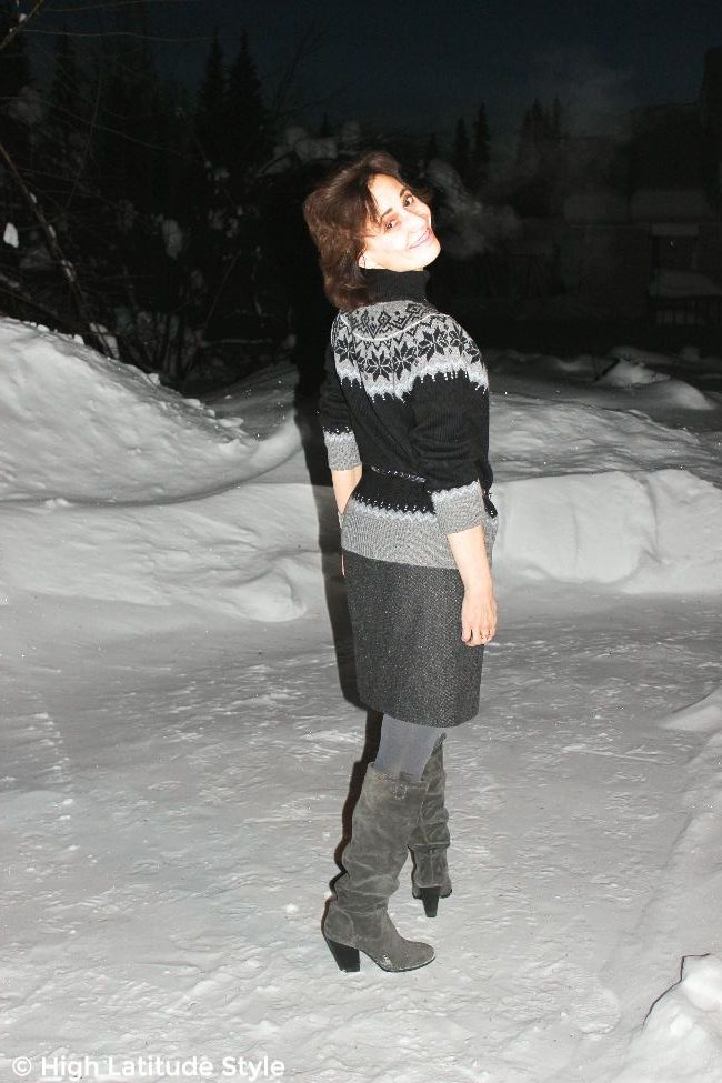style book author in coarse wool fabric skirt and Fair Isle sweater with tall boots and opaque tight