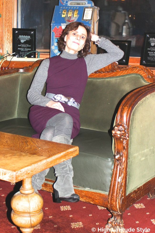 #advancedstyle woman in fitted dress with turtleneck sweater and boots