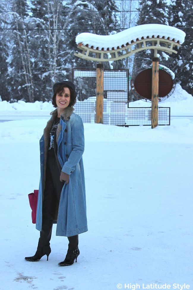 #midlifestyle woman looking posh in street chic in the snow wearing denim coat, leather beret and joggers