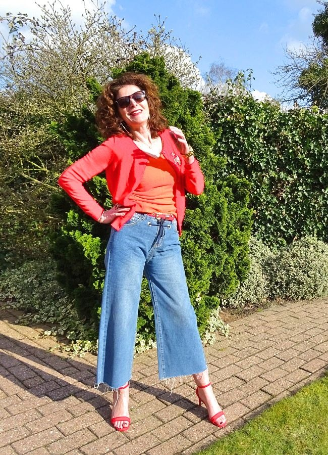 #fashionover50 fashion blogger Nancy in red orange and light blue spring outfit
