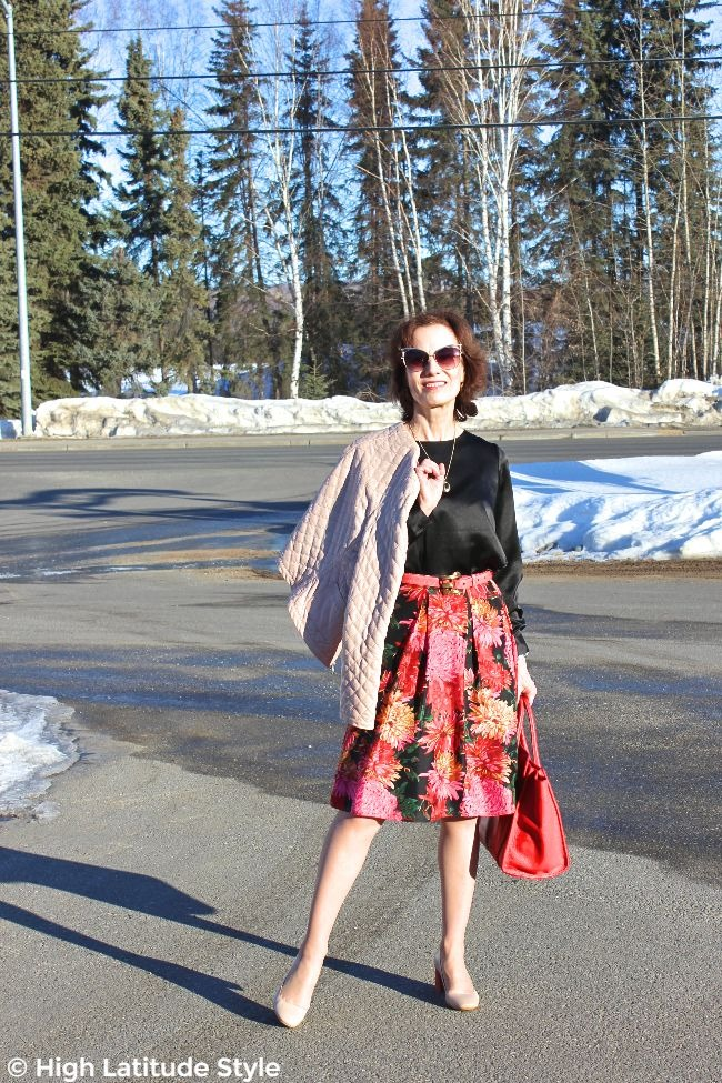 stylist in posh spring look with sunglasses, jacket, skirt, shirt, and pumps