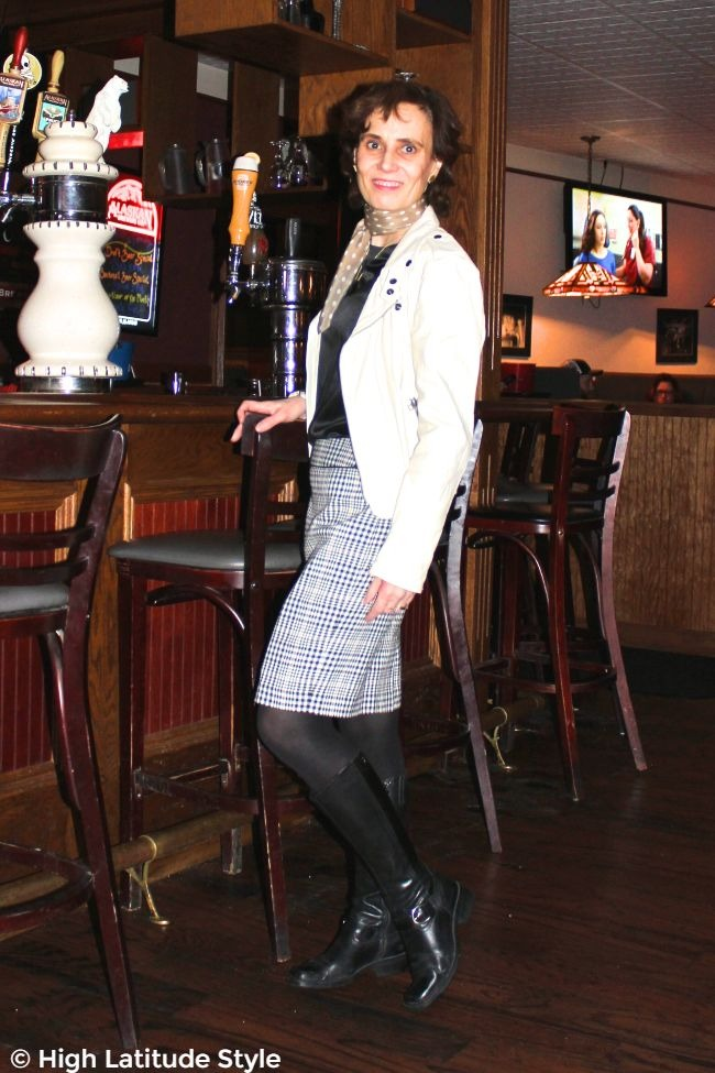 #advancedstyle midlife woman in black, tan and white mix of winter and summer clothes