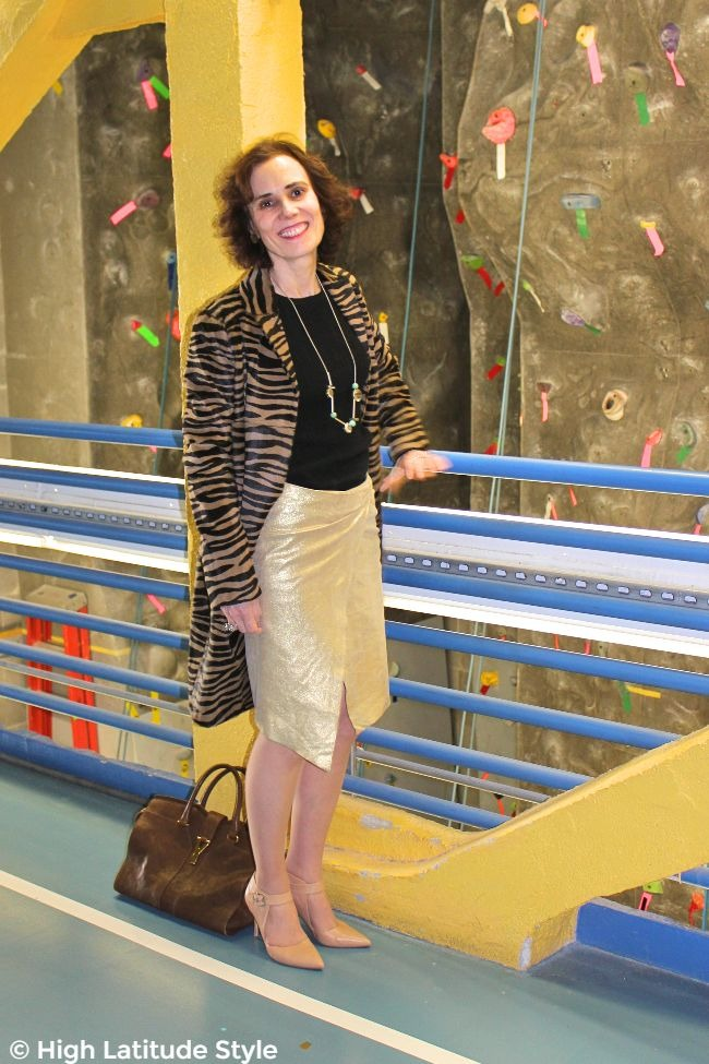 #maturestyle midlife woman looking posh in a coat, gold color skirt and knit top