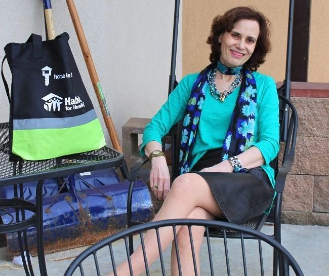 #fashionover50 woman looking tall in a teal and black work outfit with scarf, skirt and top