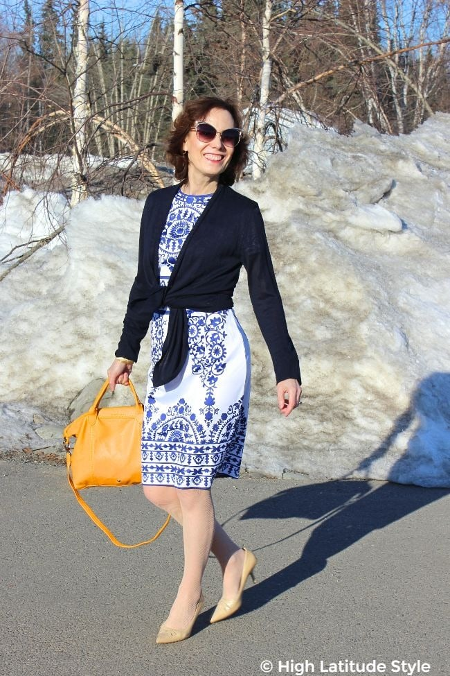 #advancedstyle mature woman dressed up for a metting in a sheath with cardigan, tote and pointy toe heels