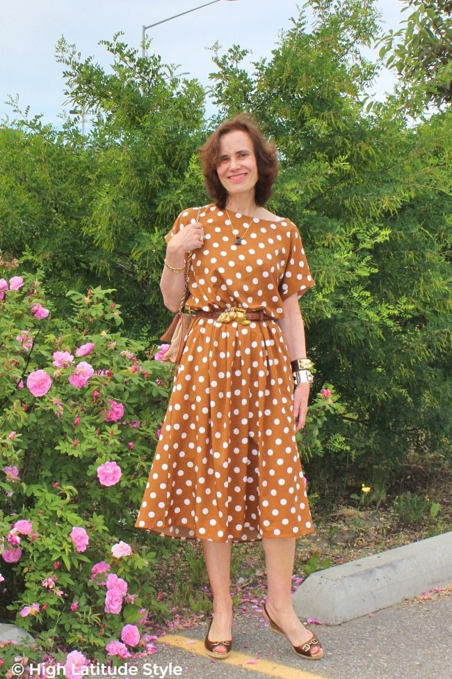 #fashionover50 style blogger in iconic Pretty Woman copper brown with white polka dot dress
