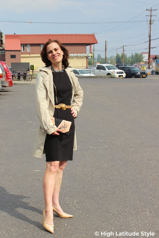 #midlifestyle woman looking elegant in LBD, trench, pumps, pearls and purse