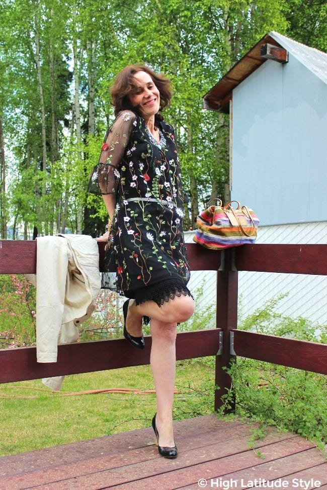 over 50 tears old fashion blogger wearing a mini dress with underskirt and patent leather pumps