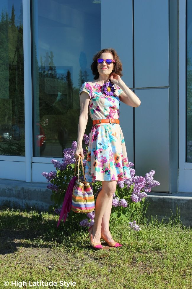 #styleover40 woman in colorful outfit with stripes and floral print