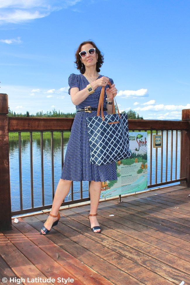 mature woman in blue and white summer look on a deck
