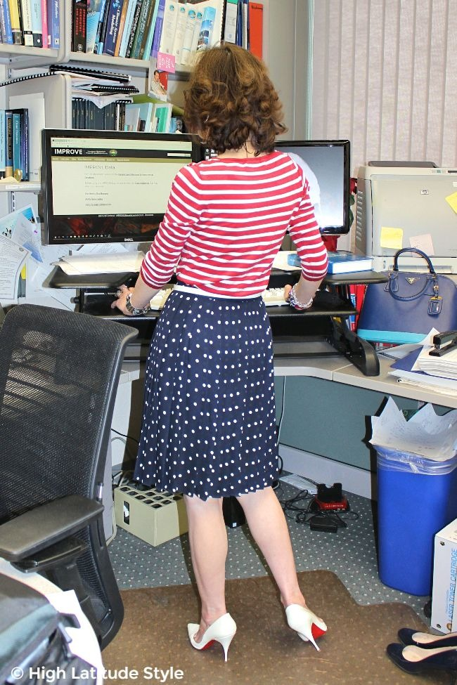 #advancedstyle midlife woman in work outfit standing in front of her desk