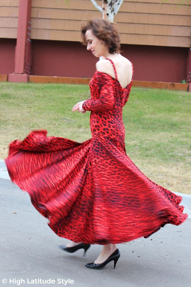 #advancedfashion mature woman twirling in a lean dance costume with wide twirling skirt
