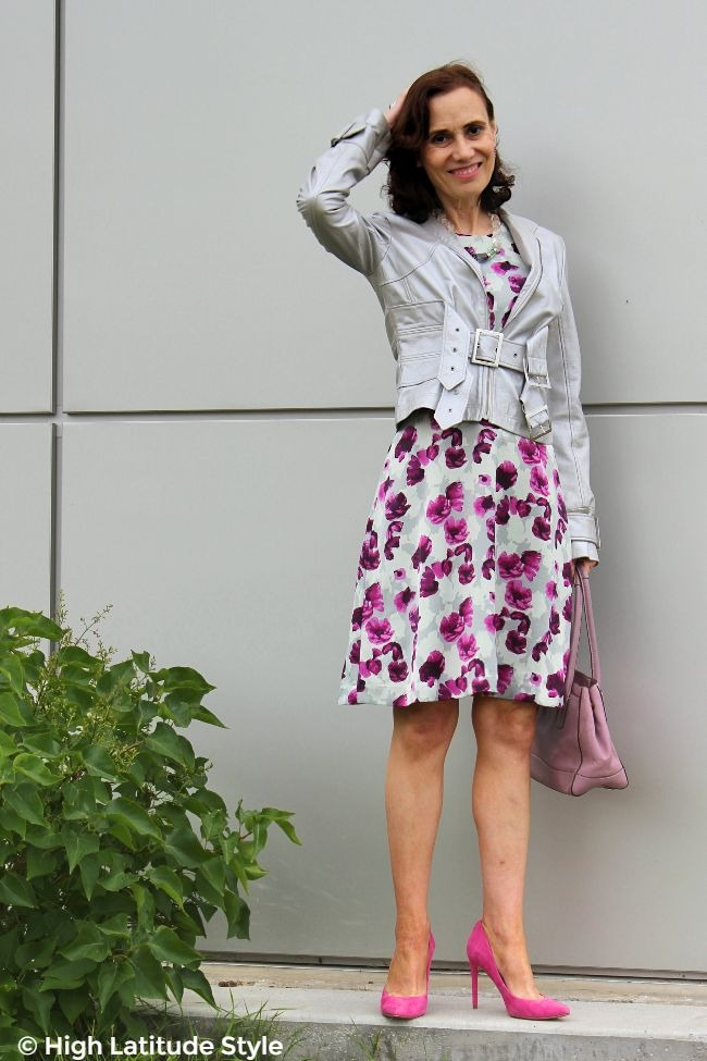#autumntrends midlife woman in silver leather jacket over abstract print dress