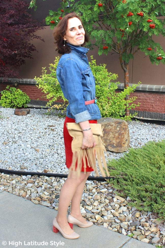 #fashionover50 woman in blue jacket, red skirt, nude purse and shoes and silver cuf