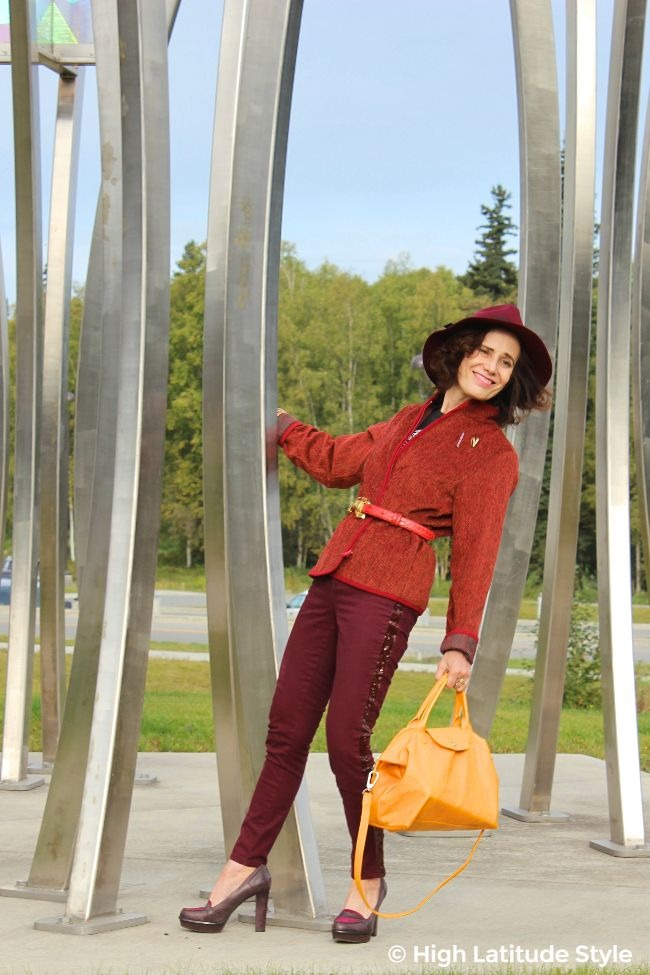 woman in monochromatic fall outfit with colored jeans and matching hat
