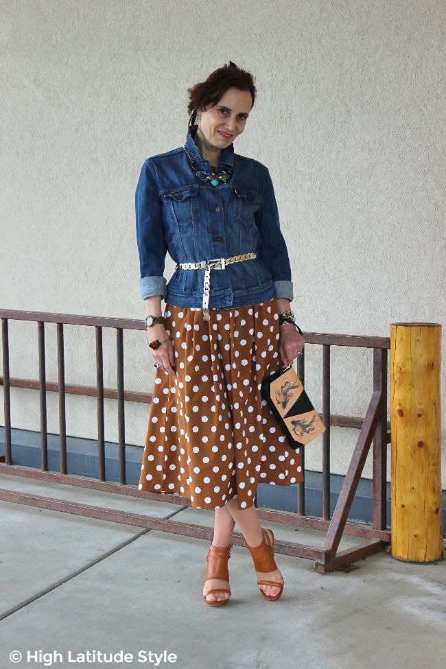 over 50 years old woman in polka dot dress with denim jacket fall wardrobe