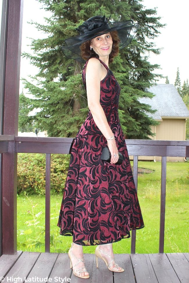 #fashionover50 southern belle in tea-length gown and statement head in northern environment