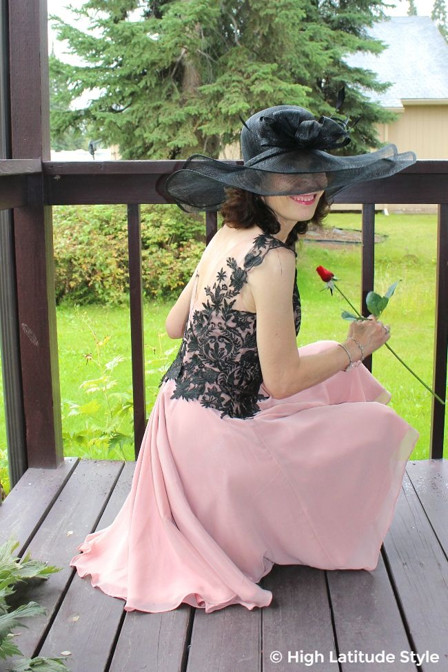 #mildifestyle woman kneeling in lace and chiffon dress with stunning head piece