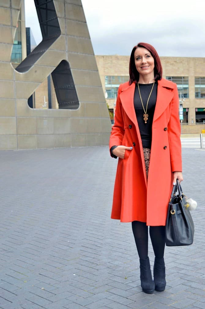 #Topoftheworldstyle #linkup Top of the World Readers' Fav Emma of Style Splash in a statement orange coat