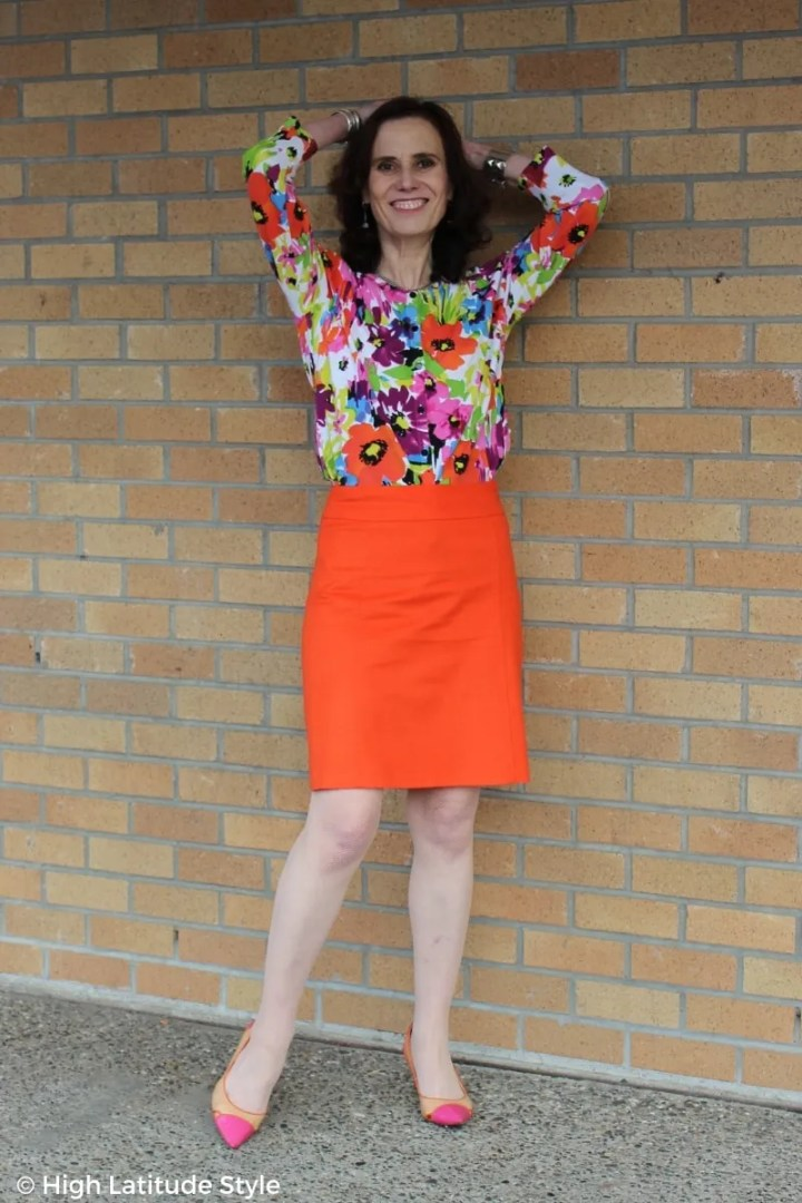 stylist and style author Nicole in floral top, straight skirt, pointy-toe multi color pumps