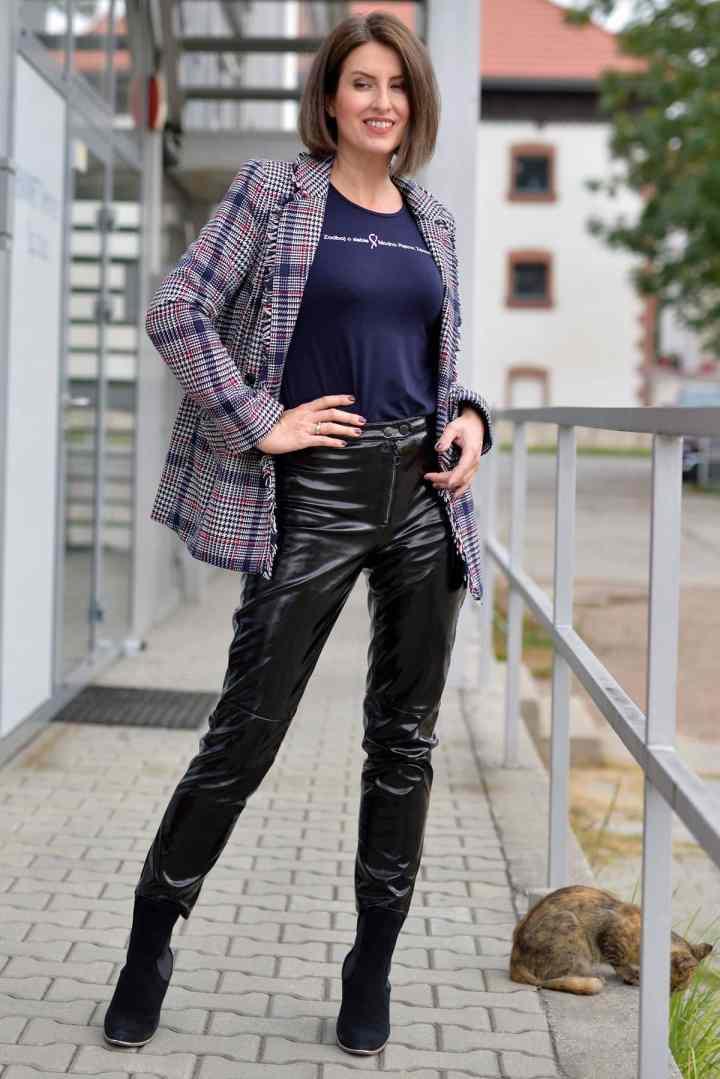 Małgorzata Trębacz Piotrowska in plaid blazer, graphic Tee and leather pants