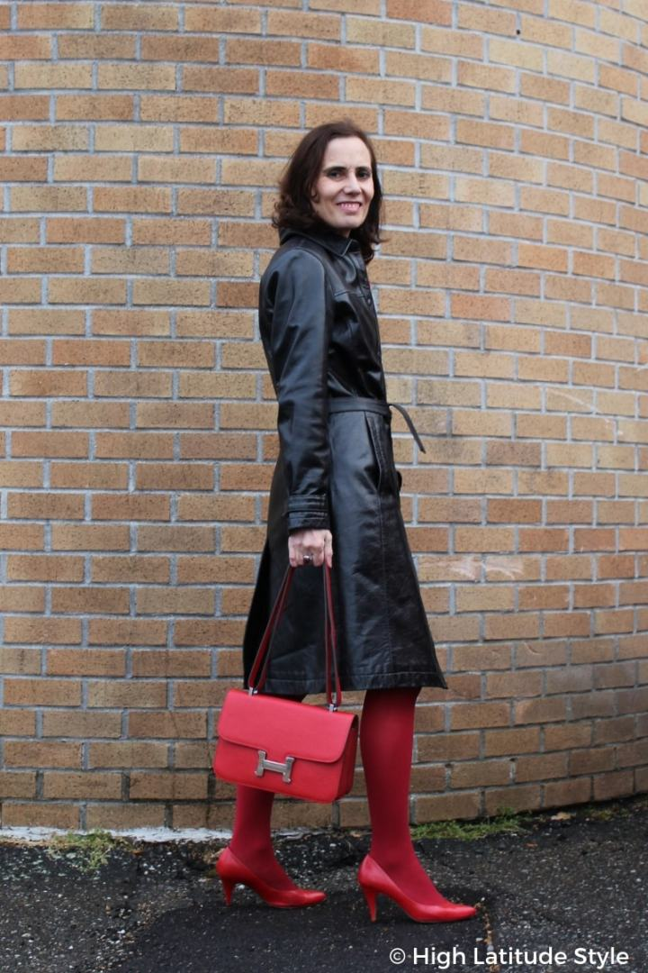 #over50fashion fashionblogger in distressed leather trench coat, red tight, pumps and bag