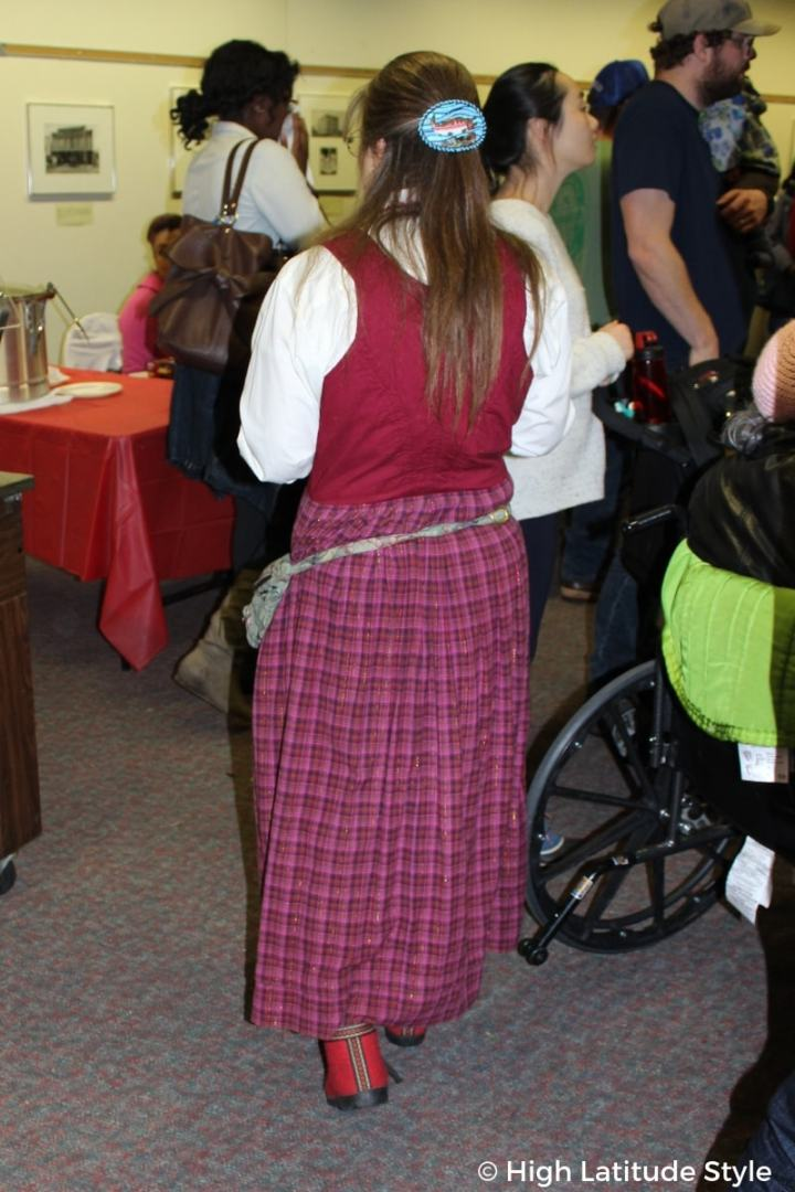 Norwegian traditional dress with plaid skirt and lobben booties