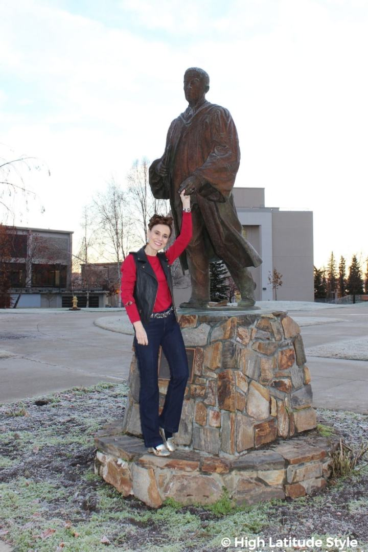 #midlifestyle blogger Nicole in jean, vest, sweater, belt and loafers on UAF campus