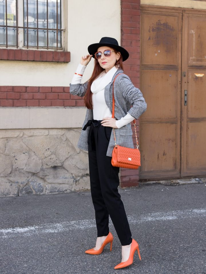 Martina at Elegant 40 in classic black pants, white crawl sweater and tweed blazer