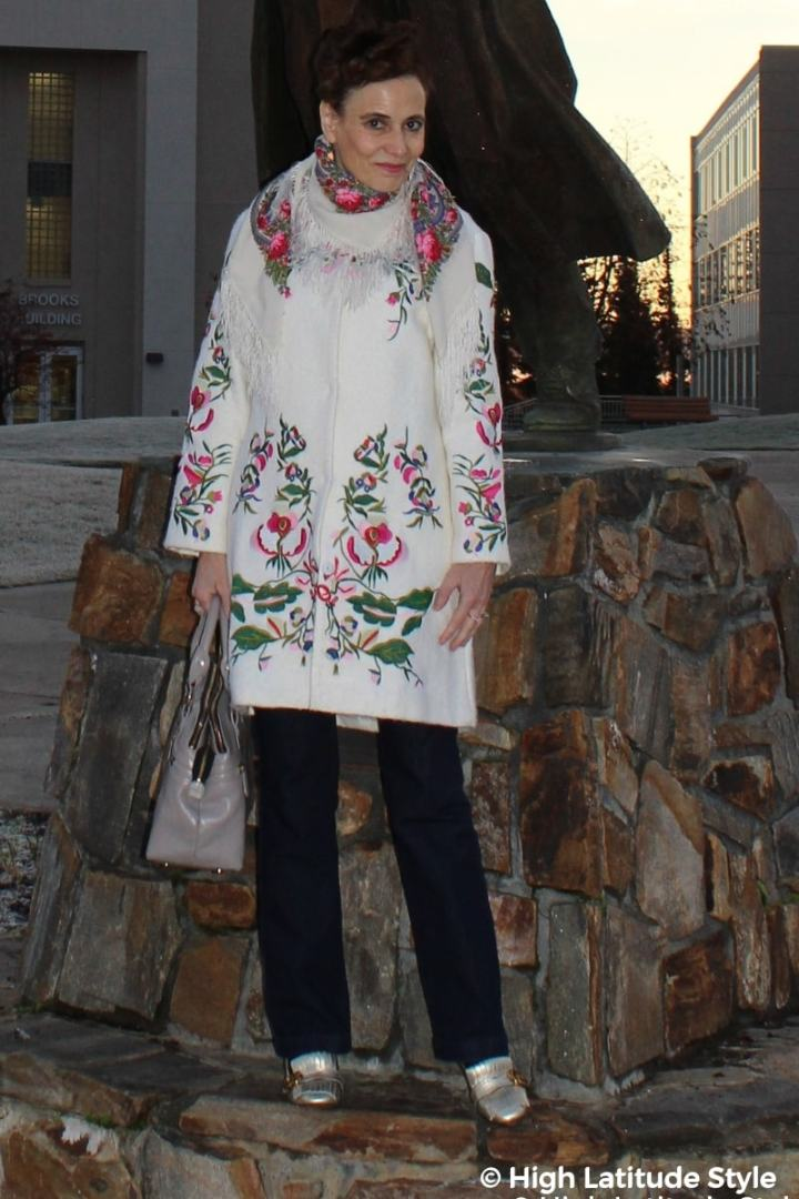 #fashionover50 50+ blogger in embroidered white coat with dark jeans