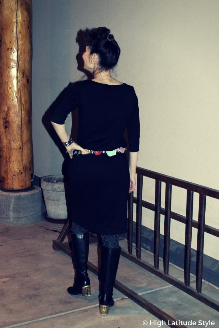 #fashionover50 #DIY woman with up-do, statement belt, and fashionable studded tall boots