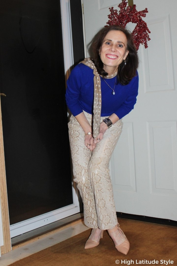 #midlifestyle mature woman in mixed prints and royal blue statement color sweater
