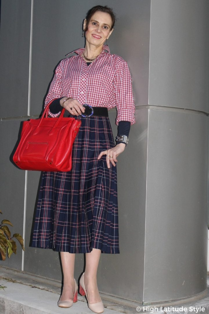 #fashionover50 style blogger mixing a gingham shirt with plaid skirt for an autumn work outfit