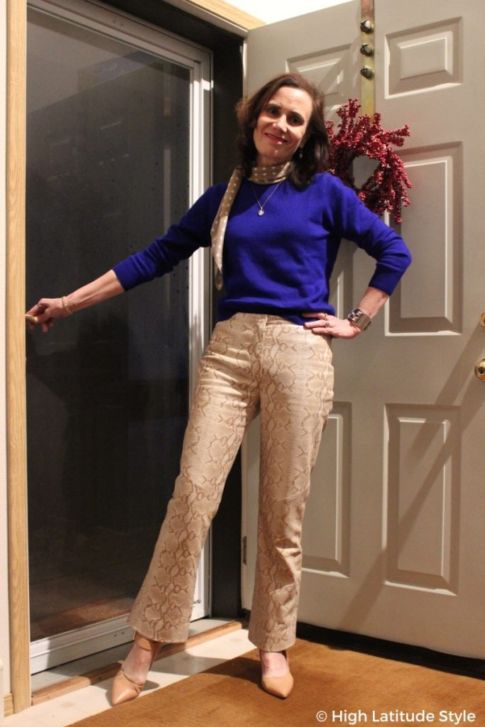 fashion blogger in trendy python print, matching pumps and scarf, royal blue sweater