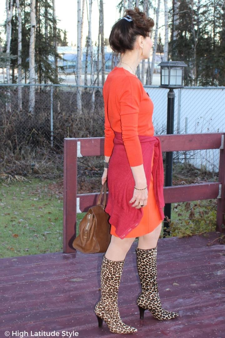 #fashionover50 High Latitude Style blogger in orange and poppy look of the day with statement leo print boots
