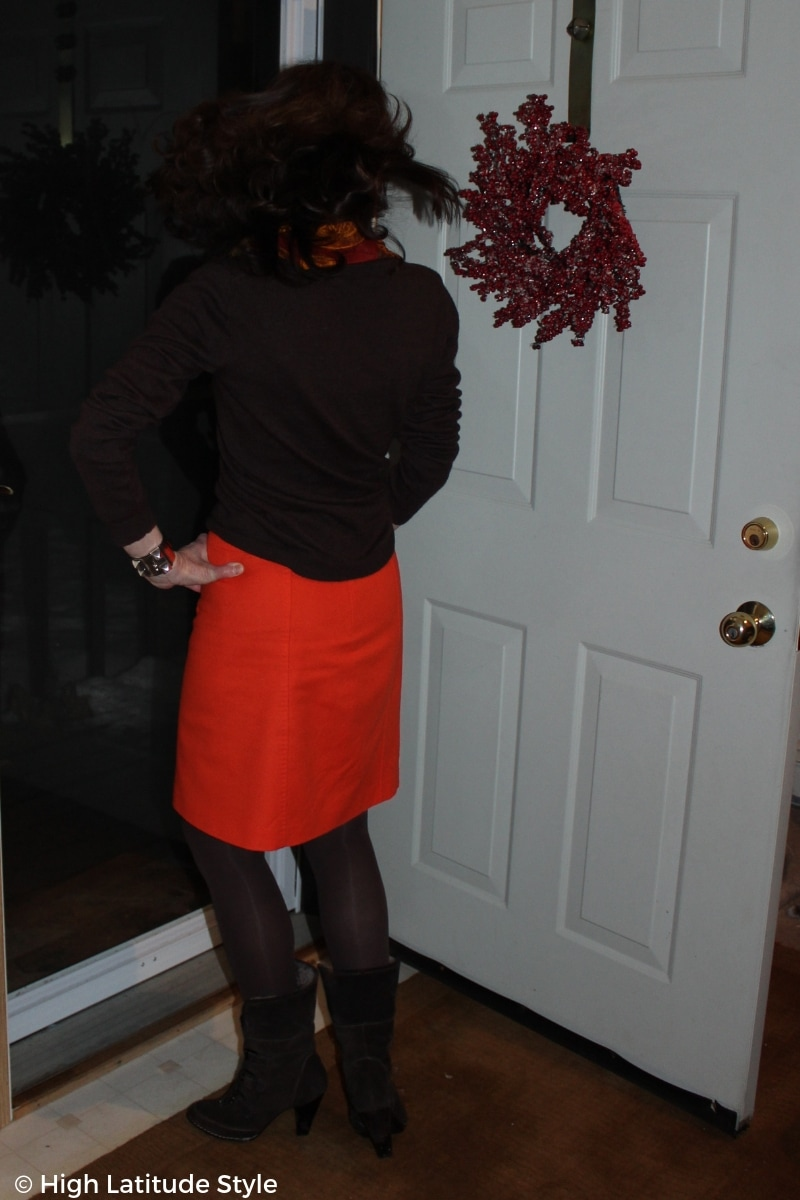 #midlifestyle snapshot of the back view of a color wheel inspired work outfit taken inside with a view on the snow outside