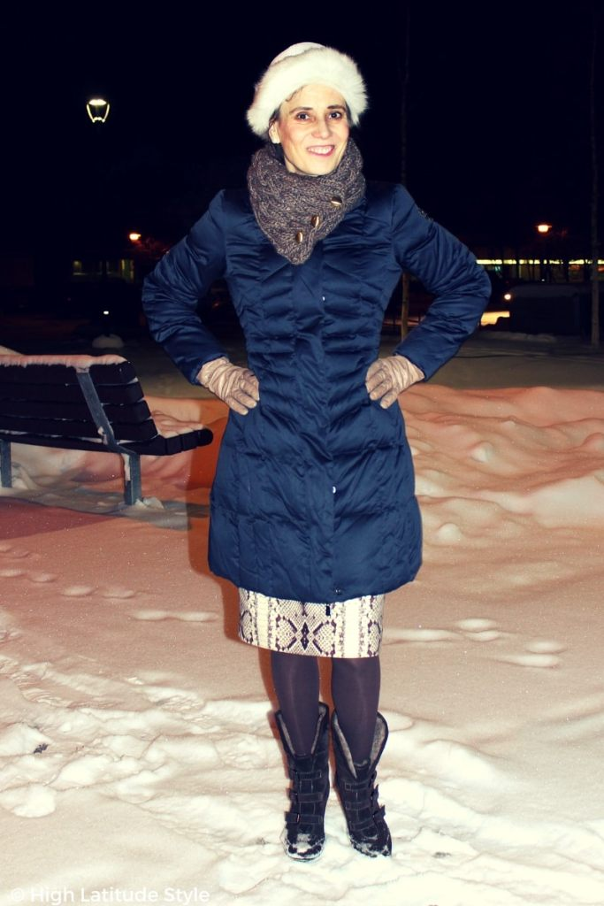 Alaskan blogger in a sleek puffer garnment with skirt, hat, scarf, booties, and tight