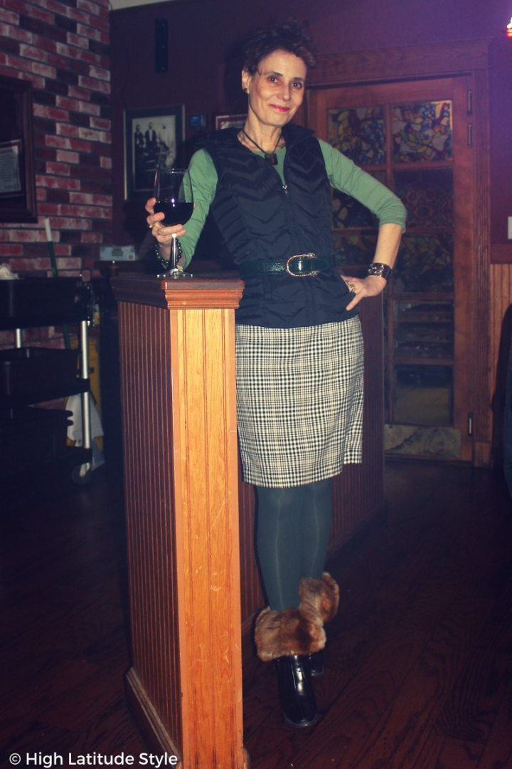 #midlifestyle lady in posh casual winter look with vest, skirt, tights and booties