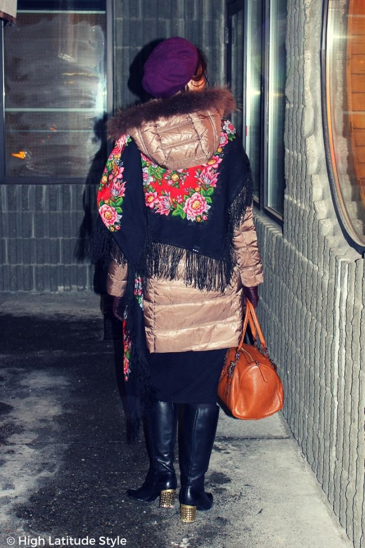#winterstyle fashionista looking cozy in a downcoat styled with Russian scarf, knit midiskirt, statement boots and beret