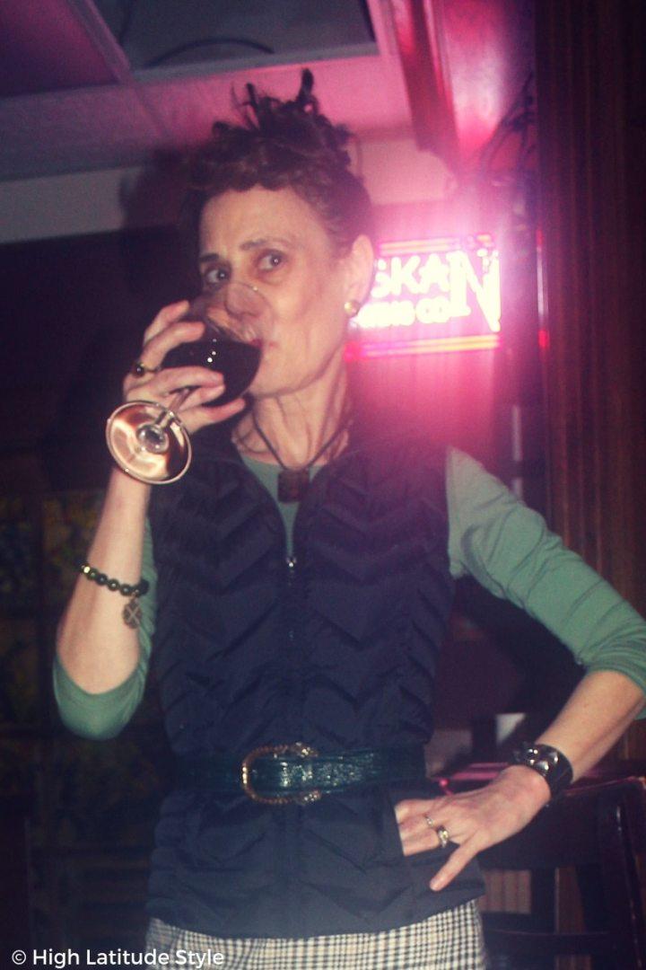 #midlifefashion woman drinking wine