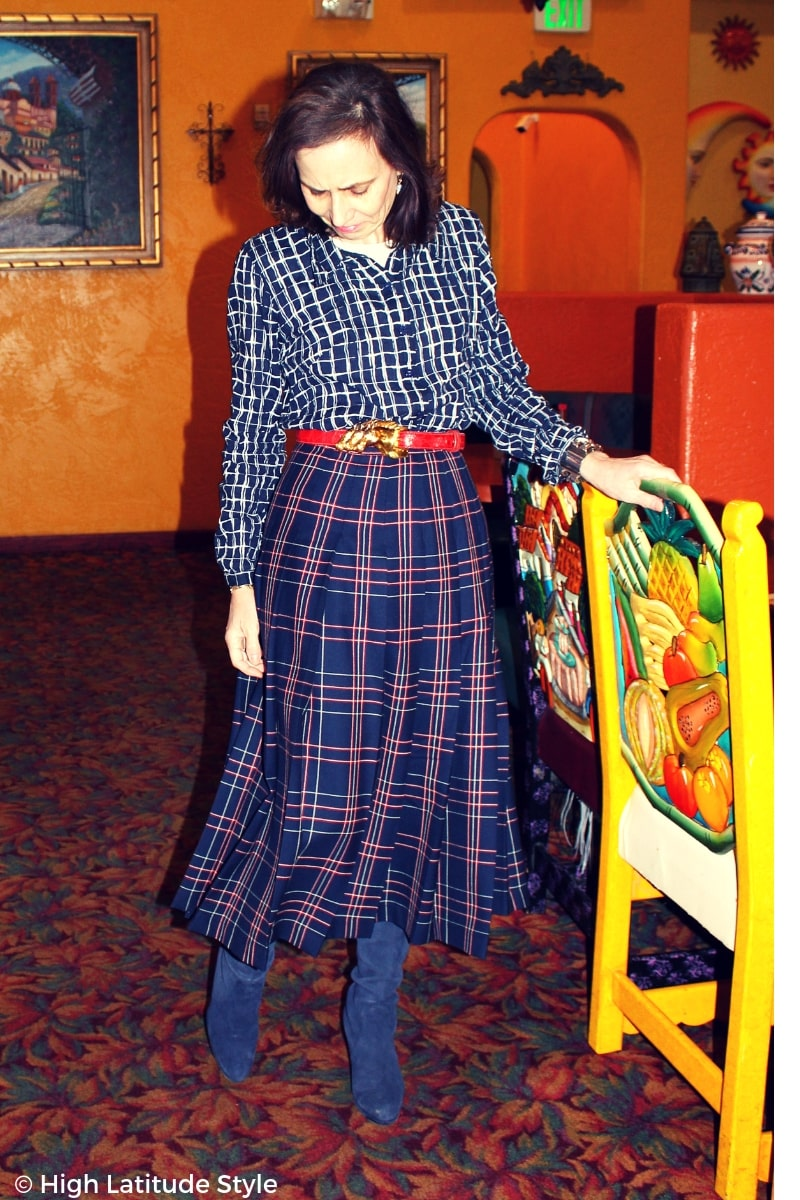 mature lady in skirt and shirt mixing plaids of different size