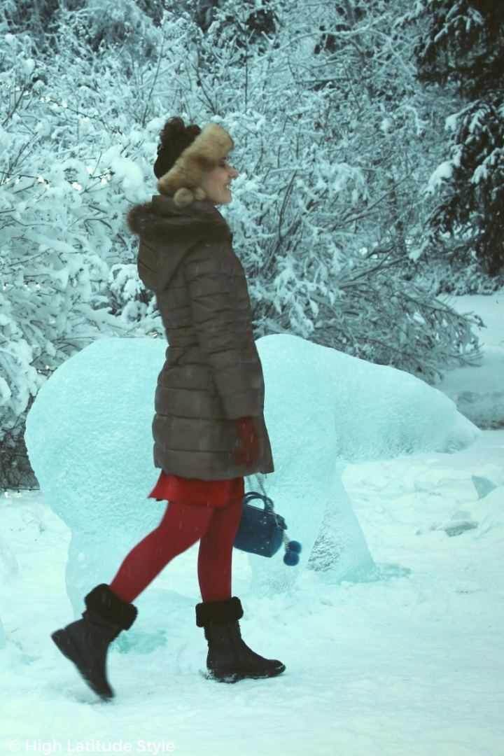 #over50fashion mature woman walking in winter wonderland