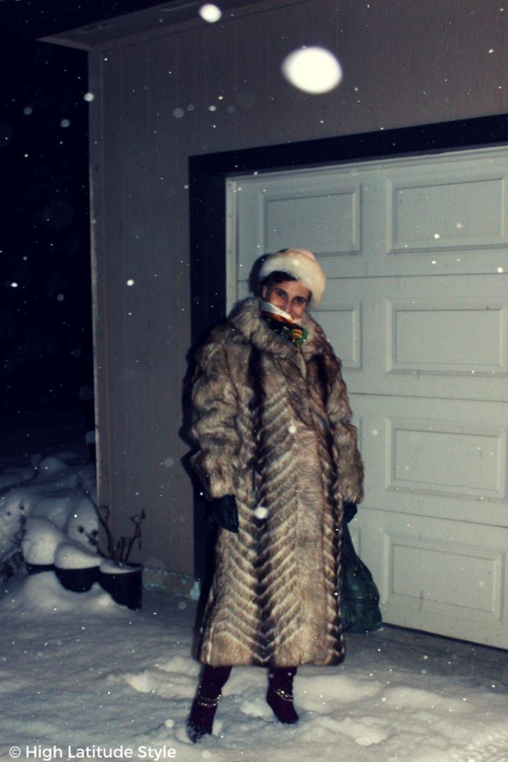 #streetstyle Alaskan blogger in winter outerwear standing outside in a snowy night