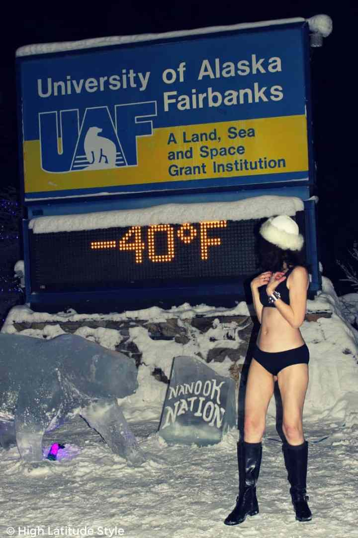 over 50 years old fashion blogger Nicole of High Latitude Style  posing in a bikini at minus 40 Fahrenheit at the University of Alaska Fairbanks campus entrance