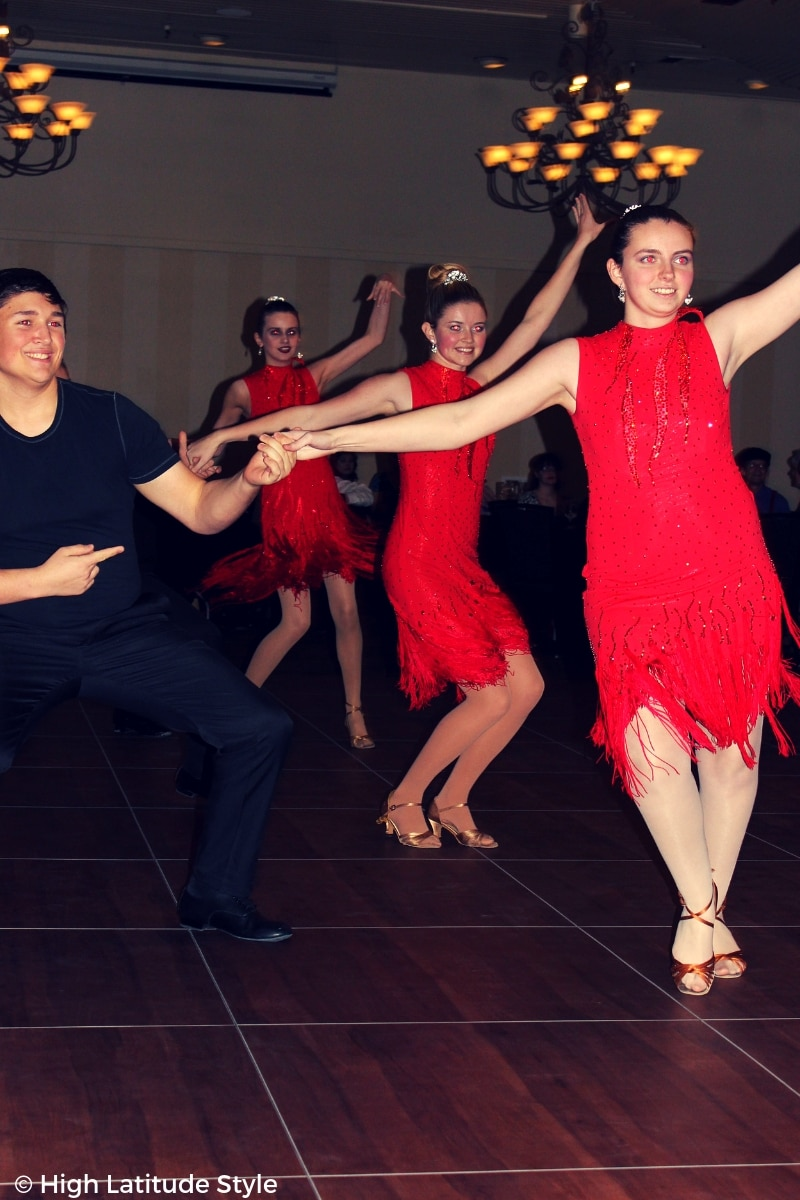 Lathrop High School competition team in red dresses