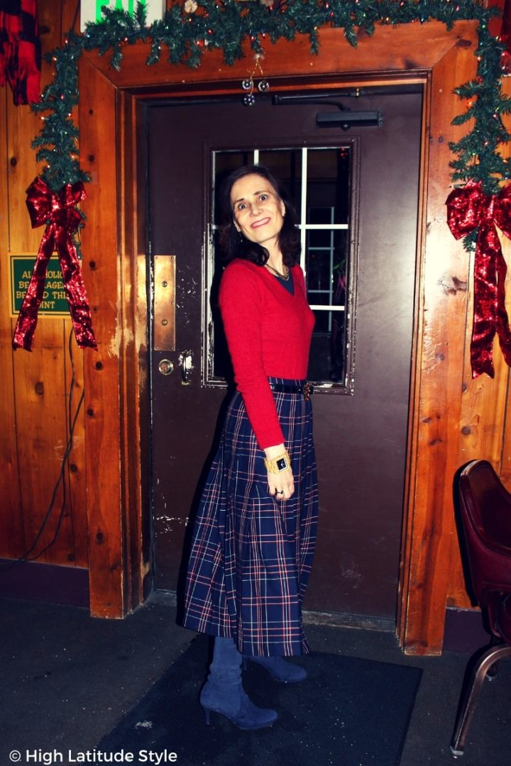 style blogger in red top over halftee with pleated plaid skirt